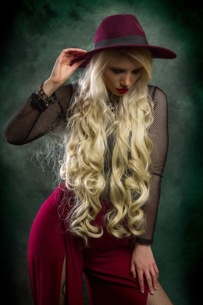 woman with blonde long curly hair